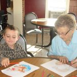 resident and visitor drawing together at the facility