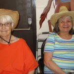 residents smiling together wearing hats