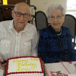 residents smiling with their birthday cake