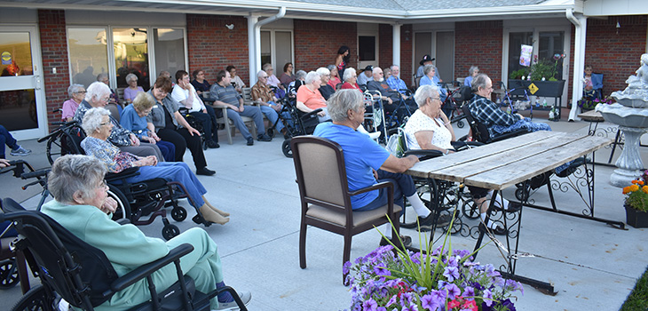 residents gathered together sitting at a memorial fund for our dining room expansion.