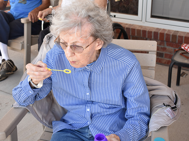 residents blowing bubbles