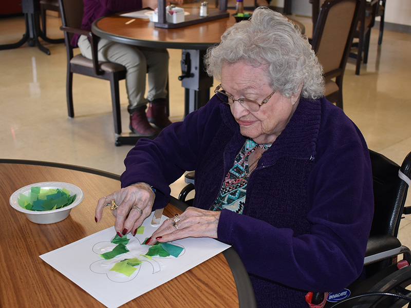 Pioneer Manor happy resident doing crafts