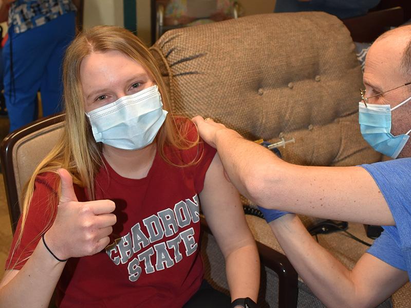 Pioneer Manor happy nurse getting a vaccination