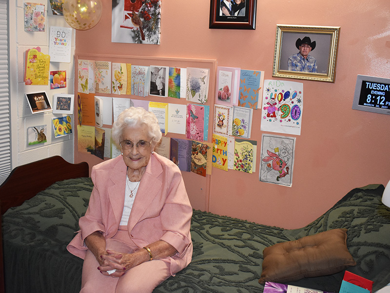 Pioneer Manor happy resident 90th birthday cards