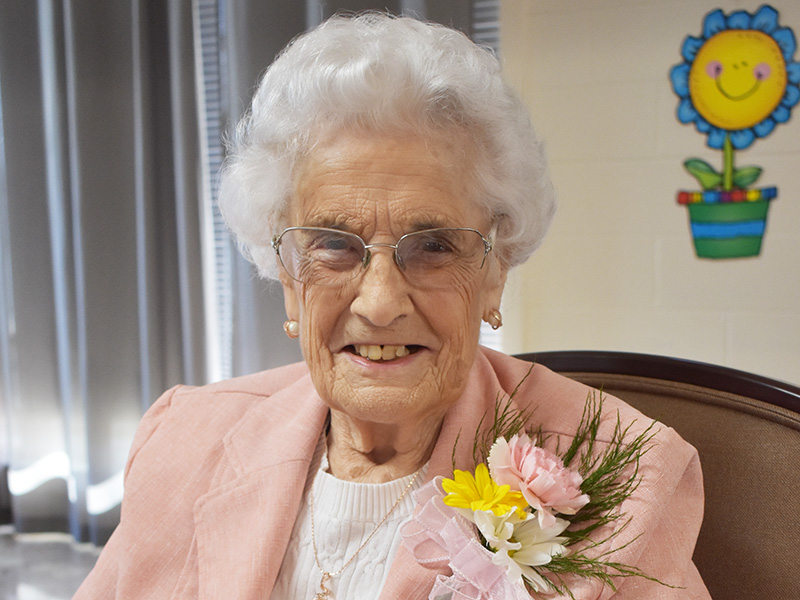 Pioneer Manor happy resident celebrating her 90th birthday