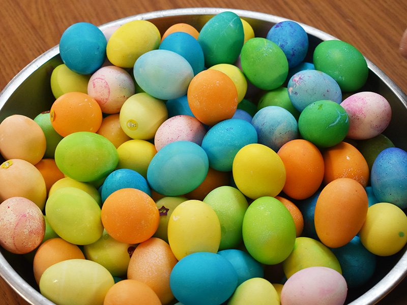 """Pioneer Manor happy resident coloring eggs """"Happy Easter."""""""