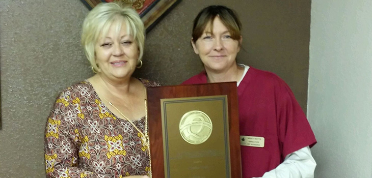 Linda Byrd, Administrator and Kristi Watts, Director of Nursing receiving the award