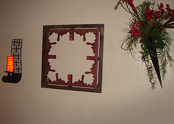 wall decor including, a candle, flower arrangement and artwork