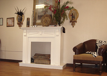 beautiful wood burning fireplace with decorated mantle
