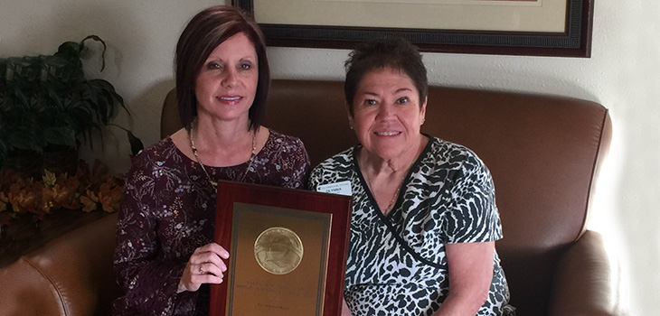 Rhonda Shirley, Administrator and Glynna Marlett, Director of Nursing accepting the bronze award