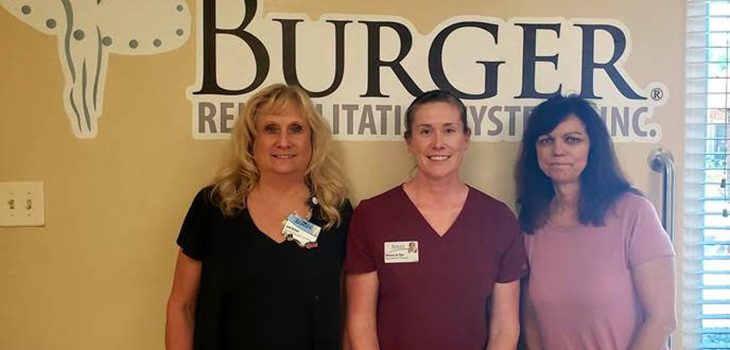 three nurses standing together smiling