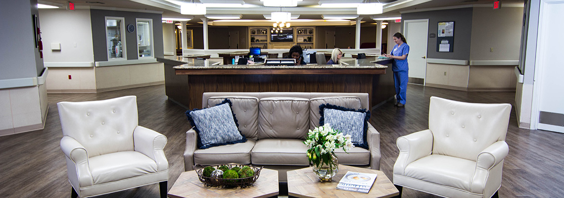 Fianna Hills nursing station and waiting area with plush leather seating and fresh flowers