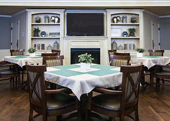 Dining room with fireplace and flat screen TV mounted on the wall