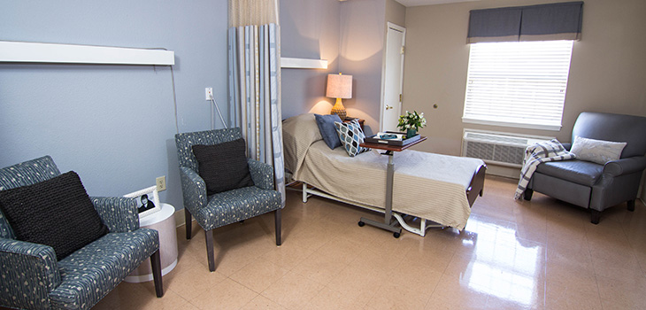 Semi private room with comfortable seating areas for family and visitors