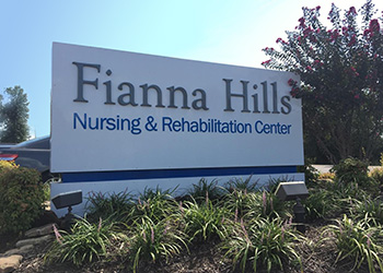 Fianna Hills sign surrounded by blooming flowers and decorative grasses