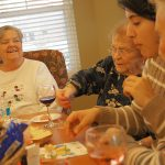 Residents enjoying snacks and wine together
