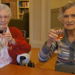 Residents raising their wine glasses