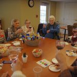 Residents having snacks and wine
