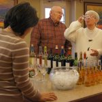 Residents enjoying happy hour with beer and wine