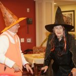 Residents and staff in Halloween costumes