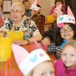 Children and residents with bunny hats on