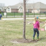Children searching for Easter eggs in the yard