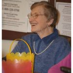 Resident smiling with her Easter basket