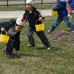 Children running to find eggs in the yard
