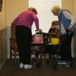 Two resident with easter egg baskets on their walkers