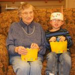 A resident and a child with their easter baskets