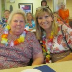 Resident with a loved one enjoying the Luau