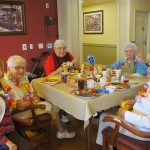 Residents enjoying their Luau food