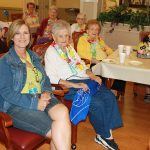 Residents and loved ones enjoying the Luau