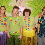 Staff members dressed up for the Luau party for the residents