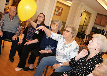 Residents hitting a balloon as a group