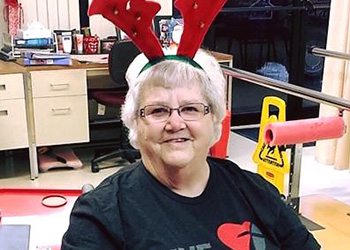 patient smiling with reindeer antlers on