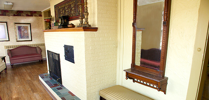 White brick fireplace in the waiting area of Argentine Care Center