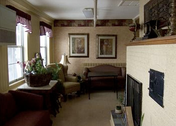 White brick fireplace and sofas in the waiting room