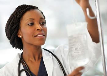 nurse touching saline bag