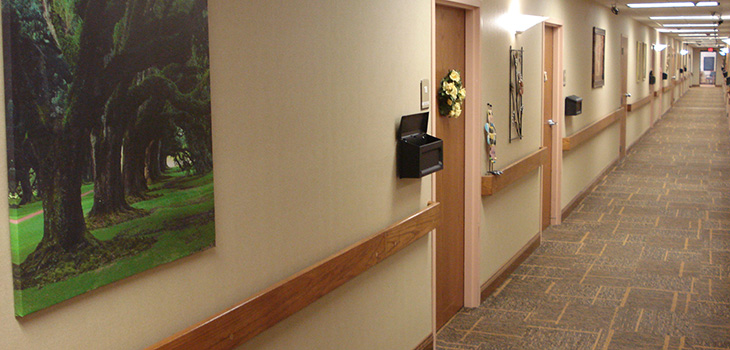 Assisted Living hallway with apartment doors and mailboxes