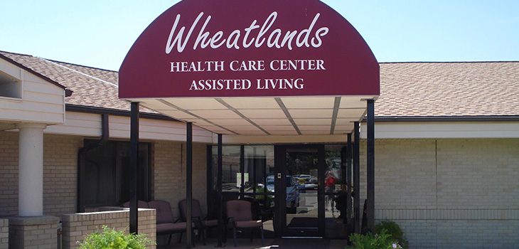 Wheatlands opening door to the facility in the daytime