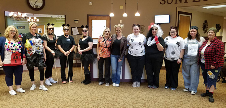 Facility employees dressed up together on halloween