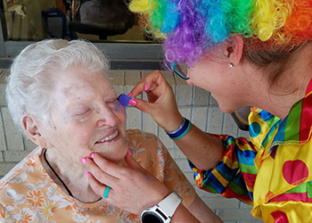 wheatlands resident getting her face painted at a party