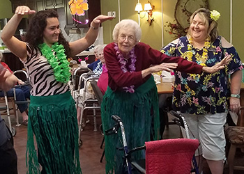 wheatlands residents dancing in a hawaiian themed party