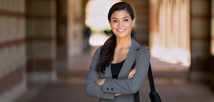 smiling female professional standing in a hallway