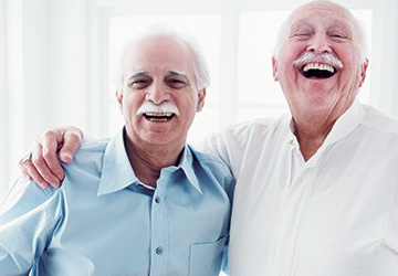 Two men laughing together.