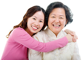 woman with her arms around her mom's shoulders