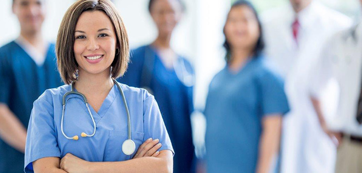 A group of healthcare professionals with scrubs and stethoscopes around their necks
