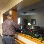 a committee member carefully decorating the garland