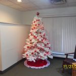 Festively decorated white and red tree